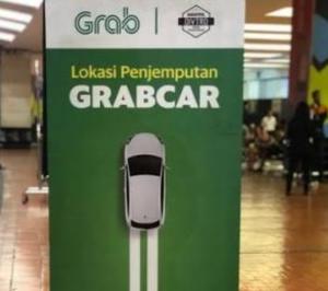 Organda Protes Grab Bandara Operasikan Mobil Plat Hitam
